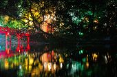 image of jade  - A night scene of the Huc Bridge leading to the Buddhist temple of the Jade Mountain on Hoan Kiem Lake in Hanoi Vietnam - JPG
