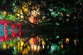 foto of jade  - A night scene of the Huc Bridge leading to the Buddhist temple of the Jade Mountain on Hoan Kiem Lake in Hanoi Vietnam - JPG