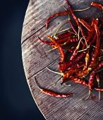 foto of red hot chilli peppers  - Red hot chili peppers on an old wooden table texture. Spicy pepper. Food photography with cope space. Shallow depth of field, selective focus ** Note: Shallow depth of field - JPG
