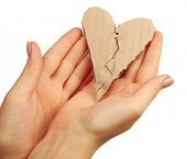 stock photo of staples  - Female hands holding broken heart stitched with staples isolated on white - JPG