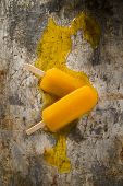 stock photo of popsicle  - Effect of melting in the heat of the all fruit popsicles - JPG