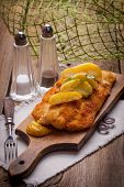 image of cod  - Fried fillet of cod with french fries on a wooden board - JPG