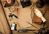 image of wood pieces  - Piece of leather and tattoo machine on vintage wood desk - JPG