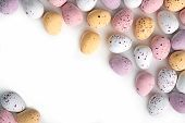 image of easter candy  - A selection of chocolate Easter Eggs with a candy crunchy shell on a white background - JPG
