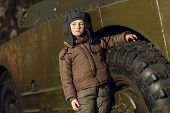 picture of panzer  - Portrait of young boy standing near by panzer - JPG