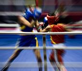 stock photo of boxing ring  - Two sportsmen boxing on a ring  - JPG