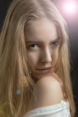 picture of thinkers pose  - pretty pensive girl looking over naked shoulder with light flare - JPG