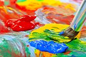 stock photo of close-up shot  - colored acrylic paint and brush close - JPG