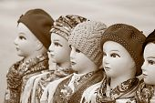stock photo of headdress  - the digital photo in tone sepia female dummies of the heads for of headdresses woolen knitted caps and silk scarves
