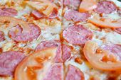 foto of hot fresh pizza  - Big hot pizza with tomatoes and salami - JPG