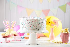 stock photo of icing  - Birthday decorated cake on colorful background - JPG