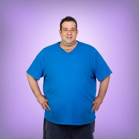 picture of morbid  - Happy fat man with blue shirt and a purple background - JPG