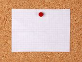 Empty note pinned on corkboard
