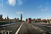 LONDON - NOVEMBER 29: London Bus on the Westminister Bridge and Big Ben with Parliament Houses on th