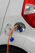 Electric cable plug into electric car socket. German prototype auto.