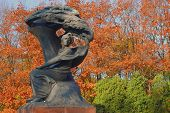 Chopin old bronze monument in Lazienki park in Warsaw. Autumn time.