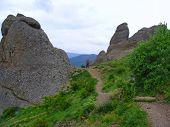 Man Passes Between Two Huge Rocks