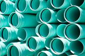 picture of pipefitter  - closeup abstract of a pile of sewer piping - JPG