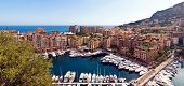 Aerial view of boats moored in marina in Fontvieille quarter or district of Principality of Monaco.