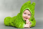 foto of baby frog  - sweet cute baby dressed in a frog suit - JPG