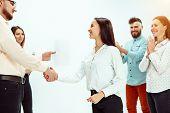 Boss Approving And Congratulating Young Successful Employee Of The Company For Her Successes And Goo poster