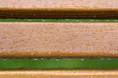 Wooden Horizontal Planks, Boards, Garden Park Bench Back With Transparent Rain Water Drops On Backgr poster