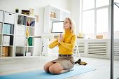 Portrait Of Contemporary Mature Businesswoman Meditating In Office, Copy Space poster