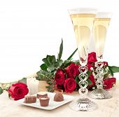picture of valentines day  - perfect valentines day surprise with chocolates roses and champagne with hart stem glass