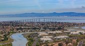 Aerial View From An Airplane Of San Mateo Hayward Bridge Across The San Francisco Bay And Foster Cit poster