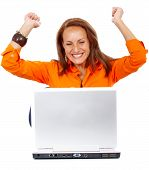 stock photo of business success  - business woman having success online on her laptop isolated over a white background - JPG
