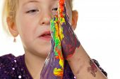 child with finger paints colors