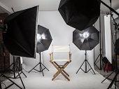 Empty Photo Studio With Lighting Equipment.photo Studio With Modern Interior And Lighting Equipment poster