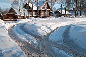 Winter road to village
