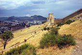Landscape With A Stone Fortress Wall On A Hill With Yellow Scorched Grass On The Background Of Mount poster