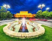 Illuminated Palace Of The Parliament Of  Bucharest At Night. Dramatic Evening View Of Palace Of The  poster