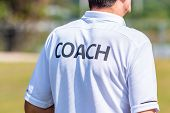 Back View Of Male Sport Coach In Coach Shirt At An Outdoor Sport Field, Good For Coaching Or Sport C poster