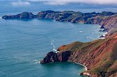 Rugged Coastal Cliffs Above The Pacific Ocean By The Point Bonita Lighthouse In Marin County Califor poster