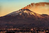 Mount Etna Volcano With Smoke At Dawn And The Catania City, Sicily Island, Italy, Europe poster