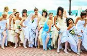 KRASNOYARSK, RUSSIA - JUNE 21: group of happy excited brides posing for photographers at Parade of Brides June 21, 2009 in Krasnoyarsk. The annual summer event takes place in many Russian cities.
