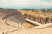 Panorama Ancient Greco Roman City. Ruins Of Ancient City Of Old Amphitheater, Hierapolis In Pamukkal poster