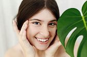 Eye Skin Care And Treatment. Portrait Of Beautiful Young Happy Woman Holding Hands At Eyes Skin At G poster