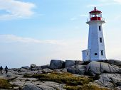Peggys Cove, Nova Scotia, Canada - July 7th, 2014: Visitors Walking Towards Peggys Point Lighthouse, poster