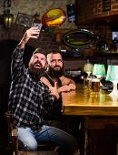 Man In Bar Drinking Beer. Take Selfie Photo To Remember Great Evening In Pub. Online Communication.  poster
