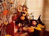 Small Girl And Father Prepare Halloween Decoration. Smal Girl And Father Carve Pumpkin Head As Decor poster