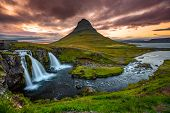 Iceland waterfall and famous mountain. Kirkjufellsfoss and Kirkjufell in northern Iceland nature lan poster