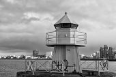 Sea Transportation And Navigation. Lighthouse On Sea Pier In Reykjavik Iceland. Lighthouse Yellow Br poster