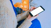 Woman Looking At Smart Phone Phone With White Blank Screen. Close Up Shot Of Woman Hands With Mobile poster
