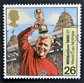 UNITED KINGDOM - CIRCA 1999: A stamp printed in Great Britain shows Bobby Moore with World Cup circa