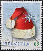 HELVETIA (SWITZERLAND) - CIRCA 2009: A christmas stamp printed in Switzerland shows christmas hat ci