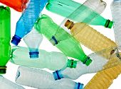 stock photo of reuse  - close up of empty used plastic bottles on white background with clipping path - JPG